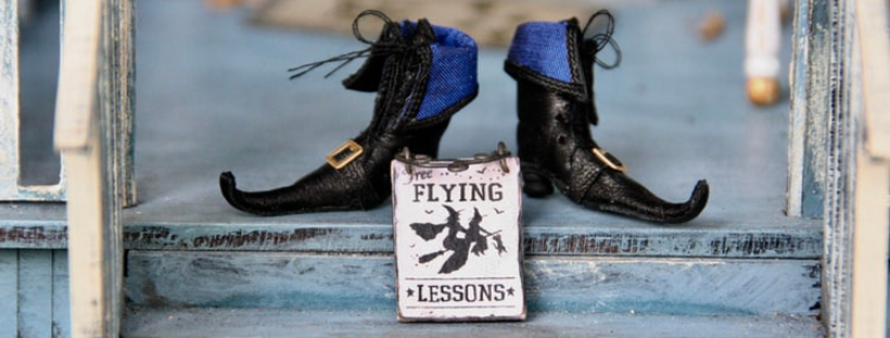 "halloween bucket list witches feed with sign that says ""flying lessons"""