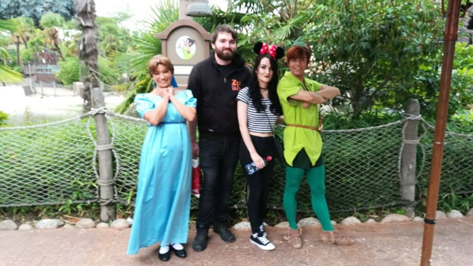 Couple in between Wendy and Peter Pan in Disneyland Paris - disneyland bucket list