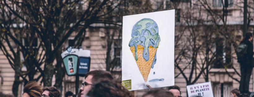 climate protest, sign of Earth on an ice-cream cone, melting