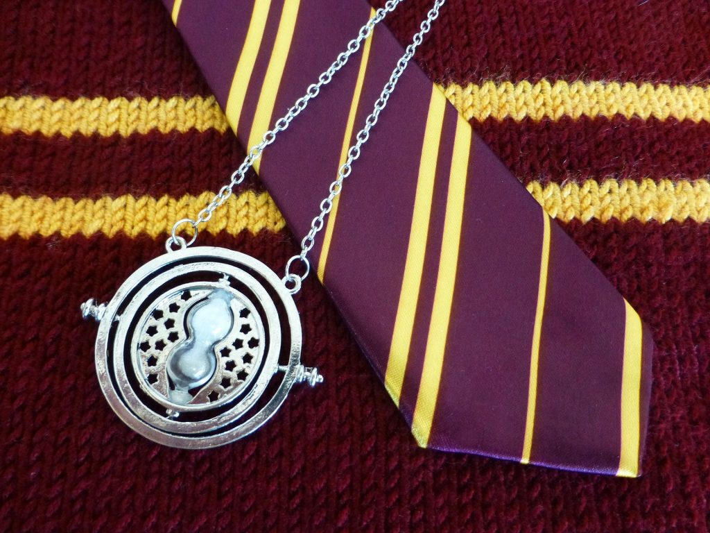 gryffinor tie, scarf, and a time-turner - harry potter things to do before you die