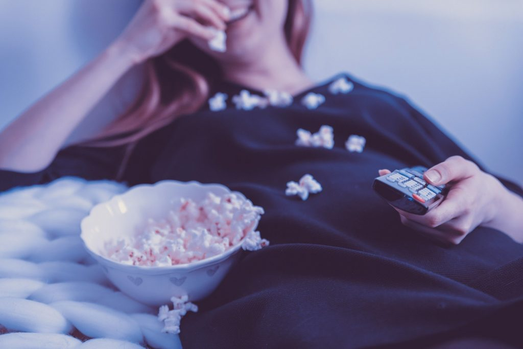 a movie night in with popcorn - little acts of self-care