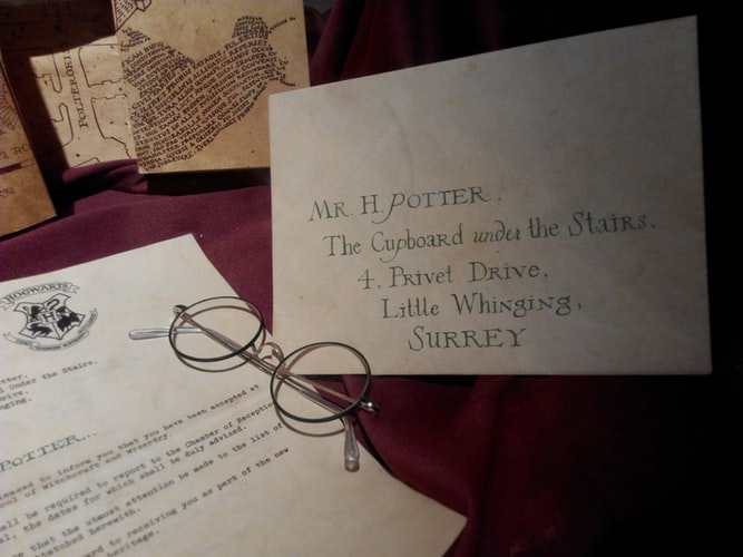 hogwarts accptance letter and glasses - harry potter things to do before you die