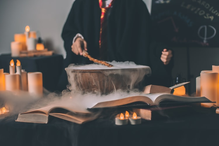 a hogwarts student brewing a potion