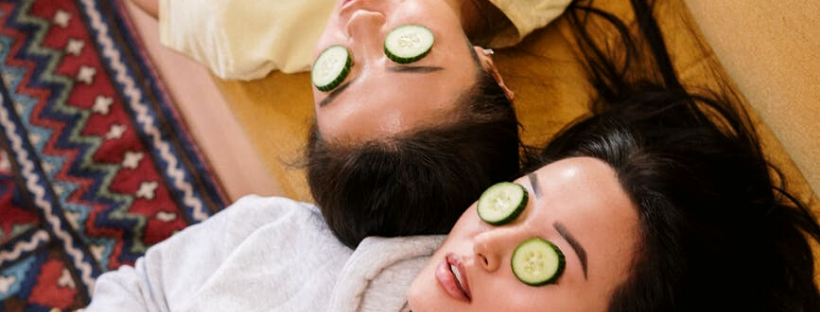girls with cucumber eye masks - green skincare regime