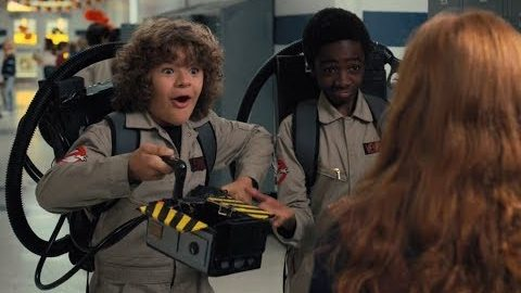 Stranger Things. Dustin and Lucas are dressed as Ghostbusters, talking to Max
