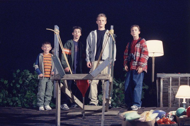Malcomn in the Middle Halloween episode; malcolm, reese, dewy, and francis are on the roof with a sling shot