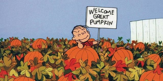 "It's the Great Pumpkin, Charlie Brown. Linus is in the pumpkin patch holding a sign that reads ""Welcome, Great Pumpkin."""