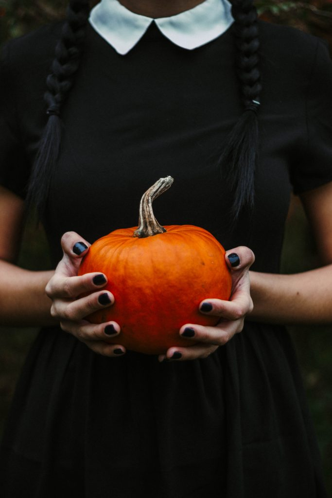 wednesday addams holding pumpkin - how to upcycle jack-o-lantern after Halloween