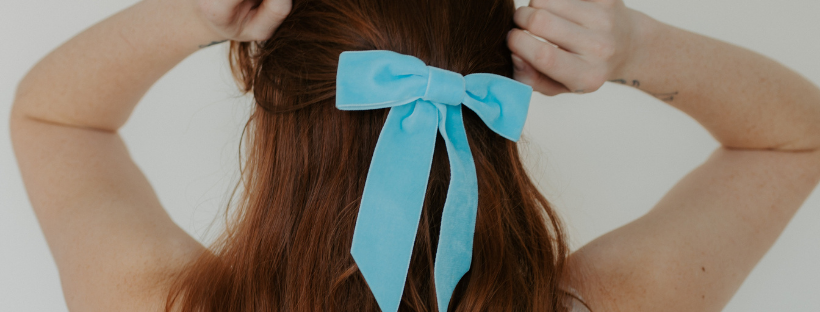 Girl with blue ribbon in her hair like Bell from Beauty in the beast (for best disey live actions list)