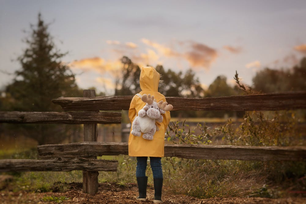 A child in a yellow rain jacket like Georgie from IT, as part of this summer horror movies list