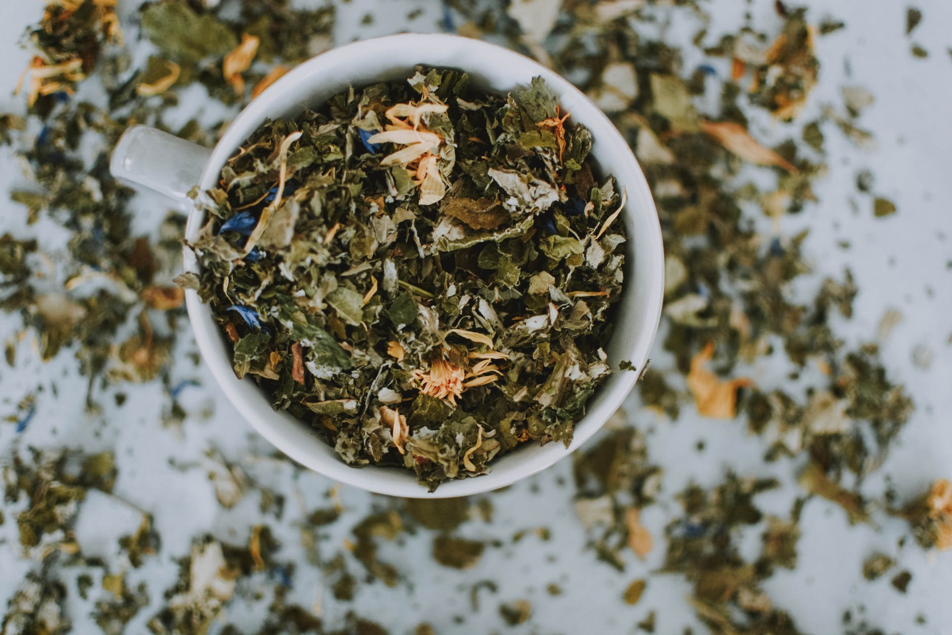 tea leaves in a white bowl