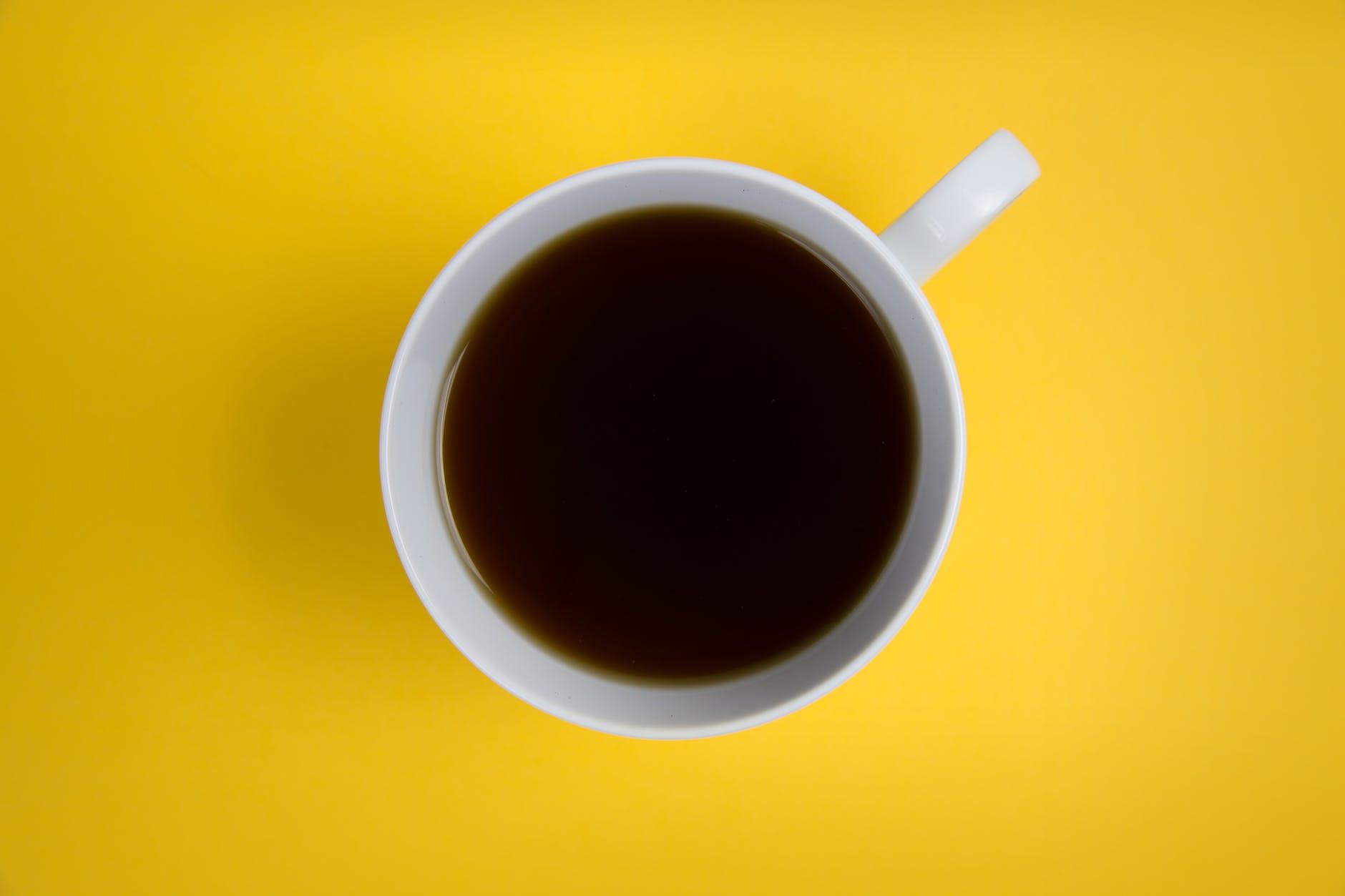 close up photo white ceramic cup